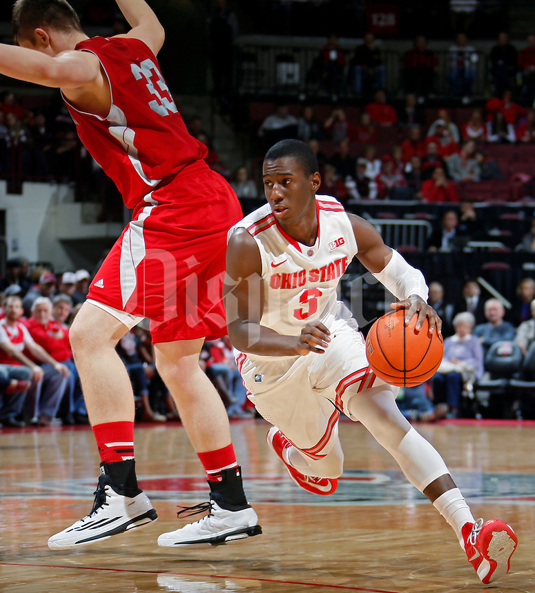 Ohio State Buckeyes guard Shannon Scott (3) gets around Sacred Heart Pioneers center Filip Nowicki (33) during the 1st half of their NCAA game at Value City Arena in Columbus, Ohio on November 23, 2014.  (Dispatch photo by Kyle Robertson)