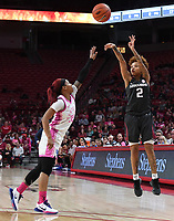 Arkansas' Alexis Tolefree sinks a three-point shot while Kentucky's Jaida Roper defends Sunday Feb 9, 2020 at Bud Walton Arena in Fayetteville. Arkansas won 103-85. More images are found at nwaonline.com/uabball/ (NWA Democrat-Gazette/J.T. Wampler)