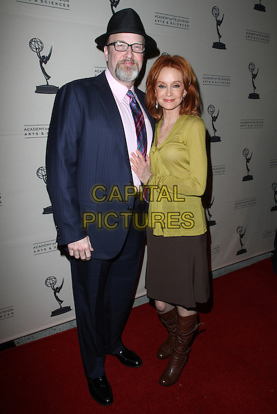 "Mark Roberts, Swoosie Kurtz.Academy Of Television Arts And Sciences Presents An Evening With ""Mike & Molly"" Held At The Leonard Goldenson Theatre, North Hollywood, California, USA, 8th March 2012..full length navy blue suit brown skirt boots  hat green top .CAP/ADM/KB.©Kevan Brooks/AdMedia/Capital Pictures."