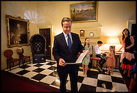 Image ©Licensed to i-Images Picture Agency. 13/07/2016. London, United Kingdom. David Cameron with his family as they wait behind the door of No10 Downing St, before facing the press and leaving the house for the last time. Picture by Andrew Parsons / i-Images