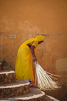 The richly colored clothing of Rajasthan's women is found worn even in the daily chores.