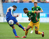 Preston North End's Lukas Nmecha battles with Wigan Athletic's Sam Morsy<br /> <br /> Photographer David Shipman/CameraSport<br /> <br /> The EFL Sky Bet Championship - Wigan Athletic v Preston North End - Monday 22nd April 2019 - DW Stadium - Wigan<br /> <br /> World Copyright © 2019 CameraSport. All rights reserved. 43 Linden Ave. Countesthorpe. Leicester. England. LE8 5PG - Tel: +44 (0) 116 277 4147 - admin@camerasport.com - www.camerasport.com