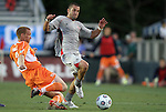 14 April 2012: Atlanta's Tony McManus (center) is challenged by Carolina's Greg Shields (SCO) (2). The Carolina RailHawks played the Atlanta Silverbacks to a 4-4 tie at WakeMed Soccer Stadium in Cary, NC in a 2012 North American Soccer League (NASL) regular season game.