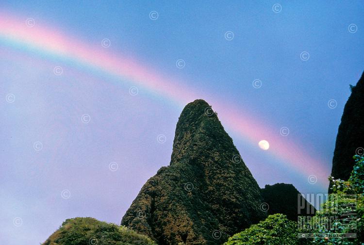 Iao Needle with rainbow and moon. Wailuku, Maui