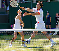 30-06-12, England, London, Tennis , Wimbledon, Jean-Julien Rojer with his mixed doubles partner Klaudia Ignacik.