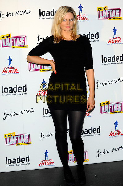 Morgana Robinson.The Loaded Lafta's at Sway, London, England..March 7th, 2013.full length black dress tights hand on hip.CAP/CJ.©Chris Joseph/Capital Pictures.