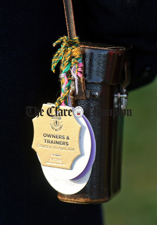 Badges on a binocular case at the Clare Hunt annual Point to Point at Bellharbour. Photograph by John Kelly.