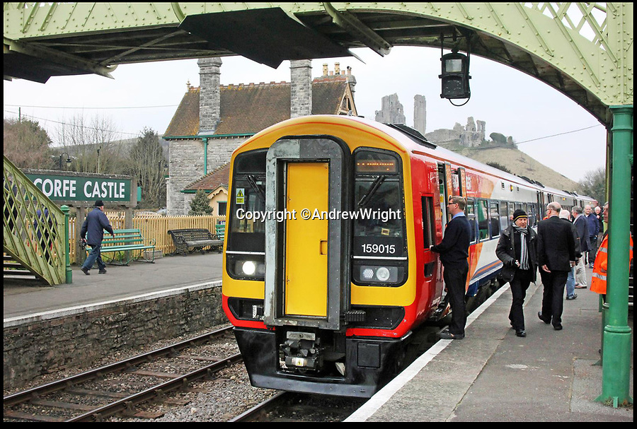 BNPS.co.uk (01202 558833)<br /> Pic: AndrewWright/BNPS<br /> <br /> The Southwest Trains service stops Corfe Castle.<br /> <br /> A public train service is to run on a railway line ripped up in the 'Beeching Axe' thanks to an army of volunteers who have spent 45 years painstakingly rebuilding it. From next month timetabled passenger trains will operate on a daily basis from the mainline down to Swanage in Dorset.The Victorian town was effectively cut off from the rail network in 1972 after Dr Richard Beeching, a government railway advisor, recommended it be one of hundreds of loss-making rural lines axed.Since then hundreds of people have restored the track which has been upgraded to meet today's safety standards.