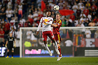 Thierry Henry (14) of the New York Red Bulls  goes up for a header with Nat Borchers (6) of Real Salt Lake. The New York Red Bulls defeated Real Salt Lake 4-3 during a Major League Soccer (MLS) match at Red Bull Arena in Harrison, NJ, on July 27, 2013.