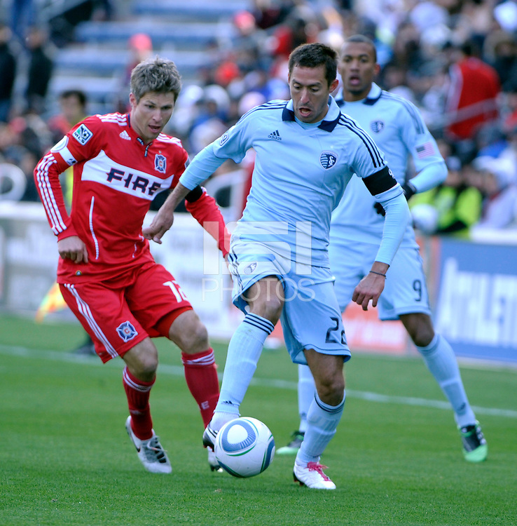 Sporting KC midfielder Davy Arnaud (22) controls the ball in front of Chicago Fire midfielder Logan Pause (12).  The Chicago Fire defeated Sporting KC 3-2 at Toyota Park in Bridgeview, IL on March 27, 2011.