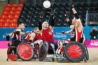 18 APR 2012 - LONDON, GBR - Great Britain's Aaron Phipps (GBR) (Class 3.5) (centre in red) passes during the London International Invitational Wheelchair Rugby Tournament match against Canada at the Olympic Park Basketball Arena in Stratford, London, Great Britain (PHOTO (C) 2012 NIGEL FARROW)