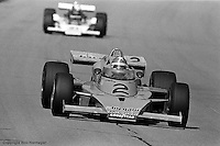Johnny Rutherford, McLaren-Offenhauser, races in the 1976 USAC Champ Car event at Michigan International Speedway near Brooklyn, Michigan.