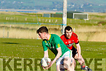 Jimmy Grady, Castlegregory looks for support with Michael Normile, Tarbert, giving chase, when the sides met at Castlegregory GAA ground last Saturday evening in Div 4 county league.