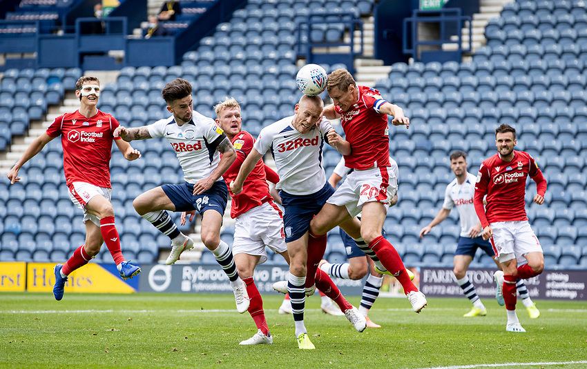Preston North End's Jayden Stockley (centre left) competing with Nottingham Forest's Michael Dawson <br /> <br /> Photographer Andrew Kearns/CameraSport<br /> <br /> The EFL Sky Bet Championship - Preston North End v Nottingham Forest - Saturday 11th July 2020 - Deepdale Stadium - Preston <br /> <br /> World Copyright © 2020 CameraSport. All rights reserved. 43 Linden Ave. Countesthorpe. Leicester. England. LE8 5PG - Tel: +44 (0) 116 277 4147 - admin@camerasport.com - www.camerasport.com