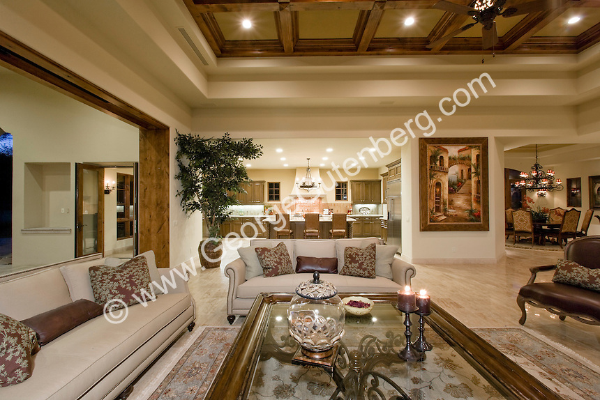Mediterranean Decore Family Room Featuring Coffered Ceilings Elegant Furnishings And Pocketed Doors That Open To
