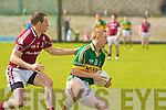 Kerry's Colm Cooper and Galway's Damien Dunleavy.