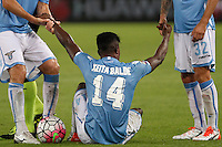 Calcio, Serie A: Lazio vs Udinese. Roma, stadio Olimpico, 13 settembre 2015.<br /> Lazio&rsquo;s Keita Diao is helped by his teammates during the Italian Serie A football match between Lazio and Udinese at Rome's Olympic stadium, 13 September 2015.<br /> UPDATE IMAGES PRESS/Isabella Bonotto