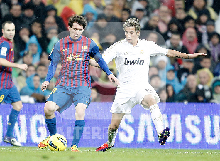 Real Madrid's Fabio Coentrao and Barcelona's Lionel Messi during La Liga Match. December 10, 2011. (ALTERPHOTOS/Alvaro Hernandez)