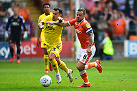 Fleetwood Town's Ross Wallace vies for possession with Blackpool's Jay Spearing<br /> <br /> Photographer Richard Martin-Roberts/CameraSport<br /> <br /> The EFL Sky Bet League One - Blackpool v Fleetwood Town - Monday 22nd April 2019 - Bloomfield Road - Blackpool<br /> <br /> World Copyright © 2019 CameraSport. All rights reserved. 43 Linden Ave. Countesthorpe. Leicester. England. LE8 5PG - Tel: +44 (0) 116 277 4147 - admin@camerasport.com - www.camerasport.com