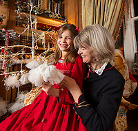BNPS.co.uk (01202 558833)<br /> Pic: PhilYeomans/BNPS<br /> <br /> Dinah's granddaughter Carla(7) lends a hand....<br /> <br /> Fairy Grandmother - Bespoke fairy maker Dinah Nicholson gets a helping hand from grandchildren Franka, Carla and Daisy this Christmas...<br /> <br /> Described as a 'Living National Treasure' by Country Life magazine her unique creations have even been supplied as wedding gifts for the bridesmaids at Royal weddings.<br /> <br /> Each of her 4159 creations so far have been logged in a fairy ledger, and the £60 cost has never been increased as 'I want everyone to be able to afford one'.