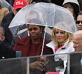 Michelle Obama and Dr. Jill Biden share an umbrella as President Donald Trump delivers his inaugural address at the inauguration on January 20, 2017 in Washington, D.C.  Trump became the 45th President of the United States.        <br /> Credit: Pat Benic / Pool via CNP