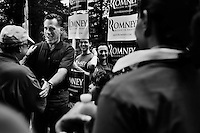 Republican presidential candidate Mitt Romney speaks to supporters at the 4th of July Parade in Amherst, New Hampshire. Republican presidential candidates Mitt Romney and Jon Huntsman walked in the parade as part of their campaign for the 2012 presidential election.