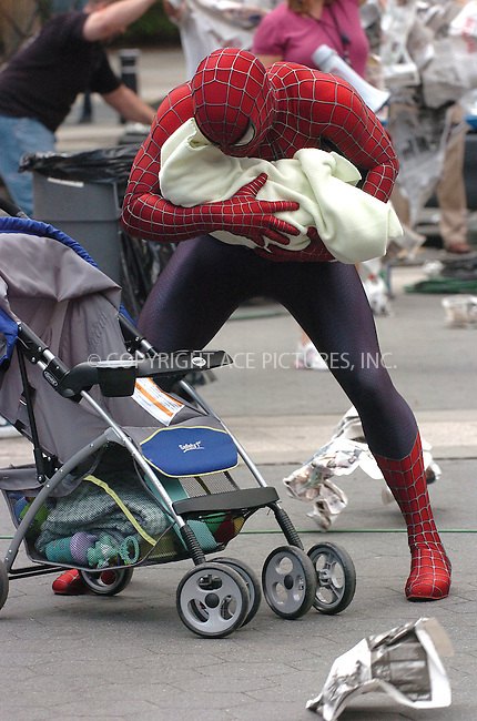 WWW.ACEPIXS.COM . . . . .  ....June 13, 2006, New York City....Spiderman saves a baby during a scene on Spiderman 3 set.......Please byline: AJ Sokalner - ACEPIXS.COM.... *** ***..Ace Pictures, Inc:  ..(212) 243-8787 or (646) 769 0430..e-mail: picturedesk@acepixs.com..web: http://www.acepixs.com
