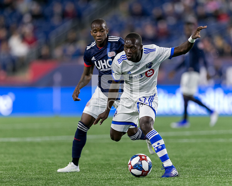 Foxborough, Massachusetts - April 24, 2019: First half action. In a Major League Soccer (MLS) match, New England Revolution (blue/white) vs Montreal Impact (white), at Gillette Stadium.