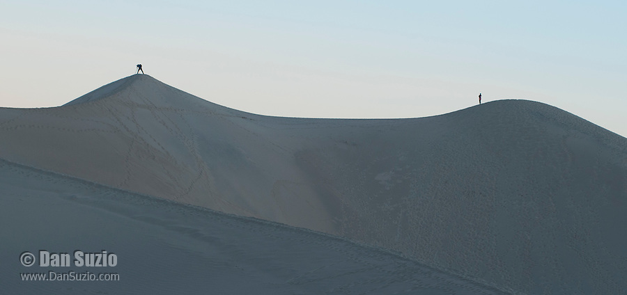 Photographers on the Mesquite Flat sand dunes at sunrise, Death Valley National Park, California