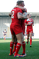 PICTURE BY VAUGHN RIDLEY/SWPIX.COM...Rugby League - International Friendly - England Knights v France - Leigh Sports Village, Leigh, England - 15/10/11…England's Josh Charnley scores a try and celebrates with Matty Smith.