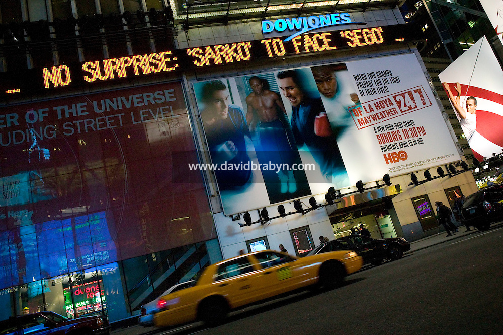 "22 April 2007 - New York City, NY - A message reading ""No surprise: 'Sarko' to face 'Sego"" - in reference to Nicolas Sarkozy's first and Ségolène Royal's second places in the first round of the French presidential elections -.scrolls on the Dow Jones zipper on Times Square in New York City, USA, 22 April 2007."