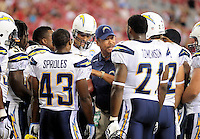 Aug. 22, 2009; Glendale, AZ, USA; San Diego Chargers running backs coach Ollie Wilson (center) speaks in the huddle as running backs (43) Darren Sproles and (21) LaDainian Tomlinson listen against the Arizona Cardinals during a preseason game at University of Phoenix Stadium. Mandatory Credit: Mark J. Rebilas-