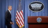 United States President Barack Obama walks to the podium to deliver a statement on the counter-ISIL campaign in the Pentagon briefing room December 14, 2015 in Arlington, Virginia. President Obama met previously with a National Security Council on the counter-ISIL campaign. <br /> Credit: Olivier Douliery / Pool via CNP