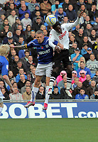 ATTENTION SPORTS PICTURE DESK<br /> Pictured: Battle for a header between L-R Craig Bellamy of Cardiff and Nathan Dyer of Swansea<br /> Re: npower Championship, Cardiff City FC v Swansea City Football Club at the Cardiff City Stadium, south Wales. Sunday 07 November 2010