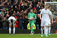 Swansea City players look dejected after Romelu Lukaku of Manchester United scores the opening goal during the Premier League match between Manchester United and Swansea City at the Old Trafford, Manchester, England, UK. Saturday 31 March 2018