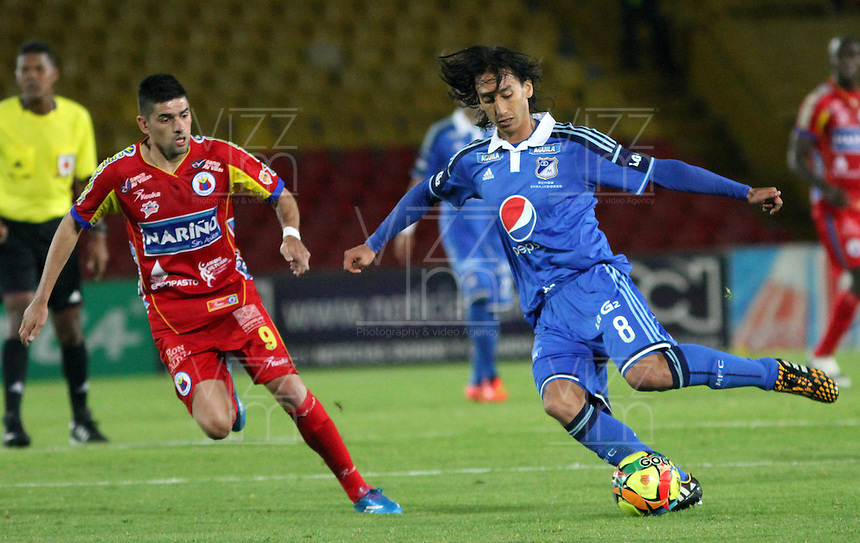 BOGOTA -COLOMBIA, 16 -AGOSTO-2014. Rafael Robayo  ( D) de  Millonarios disputa el balón con Silvio Bosco Frontan ( I ) del Deportivo Pasto durante partido de la  quinta  fecha  de La Liga Postobón 2014-2. Estadio Nemesio Camacho El Campin  . / Rafael Robayo  (R ) of Millonarios   fights for the ball with Silvio Bosco Frontan  of Deportivo Pasto during match of the 5th date of Postobon  League 2014-2. Nemesio Camacho El Campin  Stadium. Photo: VizzorImage / Felipe Caicedo / Staff