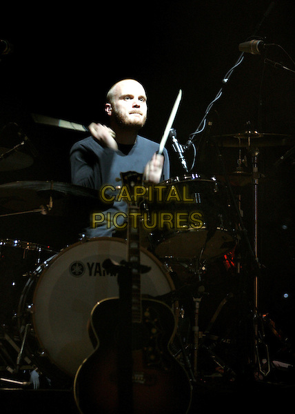 "COLDPLAY - WILL CHAMPION.Performing live at Verizon Wireless during their ""Twisted Logic Tour"" in support of their new album ""X&Y"" in Irvine, California. .August 20th, 2005.stage concert live gig performance half length drums.www.capitalpictures.com.sales@capitalpictures.com.Supplied by Capital Pictures"
