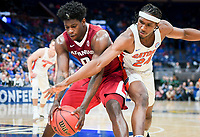 NWA Democrat-Gazette/CHARLIE KAIJO Arkansas Razorbacks guard Jaylen Barford (0) protects the ball from Florida Gators guard Deaundrae Ballard (24) during the Southeastern Conference Men's Basketball Tournament quarterfinals, Friday, March 9, 2018 at Scottrade Center in St. Louis, Mo.