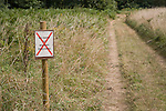 No entry sign for military personnel sign on country path, Sutton, Suffolk, England