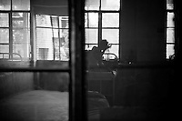 Tuberculosis patients are seen through a window in the mens ward at the Rajan Babu TB hospital in new Delhi, India.