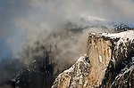 Half Dome obscured by clouds in the late afternoon, winter snow, Yosemite National park