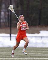 Syracuse University defender Linley Block (16) passes the ball.   Syracuse University (orange) defeated Boston College (white), 17-12, on the Newton Campus Lacrosse Field at Boston College, on March 27, 2013.