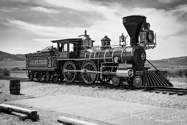 Central Pacific Railroad #60, the Jupiter, sits on the rails at Golden Spike National Historic site at Promontory Summit in Utah. On May 10, 1869, the original Jupiter along with the Union Pacific's No. 119 where placed nose to nose a railroad tie width apart during the driving of the Golden Spike that completed the Transcontinental Railroad. The original Jupiter was lost to the scrap heap and in honor of the Transcontinental Railroad's bicentennial in 1969 a reproduction of the original was made.
