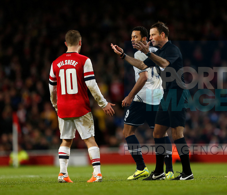 Referee Mark Clattenburg allows play to continue as Arsenal's Jack Wilshere and Tottenham's Mousa Dembele clash<br /> <br /> Arsenal vs Tottenham Hotspur - FA Cuo 3rd Round - Emirates Stadium- London - England - 04/01/2014  - Pic David Klein/Sportimage