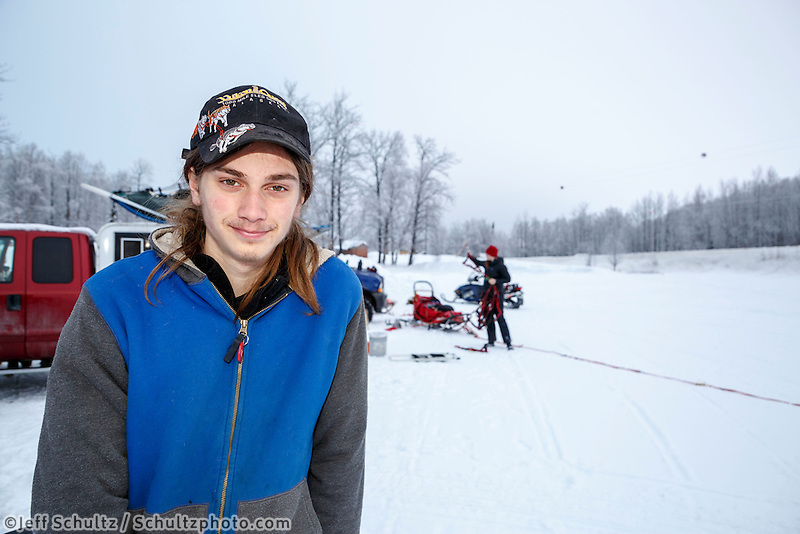 Junior Musher Logan McCready-DeBruin at Knik during the start of the Junior Iditarod on Saturday February 25, 2017. <br /> <br /> <br /> Photo by Jeff Schultz/SchultzPhoto.com  (C) 2017  ALL RIGHTS RESVERVED