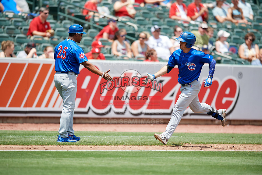 Iowa Cubs right fielder Bijan Rademacher (24) is congratulated as he rounds third base after hitting a home run in the top of the fourth inning during a game against the Memphis Redbirds on May 29, 2017 at AutoZone Park in Memphis, Tennessee.  Memphis defeated Iowa 6-5.  (Mike Janes/Four Seam Images)