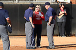 RALEIGH, NC - MARCH 29: Liberty head coach Dot Richardson talks to first base umpire Alex Leap (left) and third base umpire David Brewer (right). The North Carolina State University Wolfpack hosted the Liberty University Flames on March 29, 2017, at Dail Softball Stadium in Raleigh, NC in a Division I College Softball game. Liberty won the game 5-3.