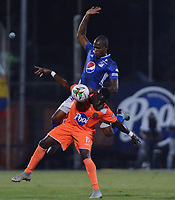 ENVIGADO -COLOMBIA, 27-01-2019: Brayan Lucumi de Envigado disputa el balón con Jair Palacios Silva de Millonarios durante partido por la fecha 1 de la Liga Águila I 2019 entre Envigado FC y Millonarios jugado en el Polideportivo Sur de la ciudad de Envigado. / Brayan Lucumi of Envigado fights for the ball with Jair Palacios Silva of Millonarios during match for the date 1 of the Aguila League I 2019 between Envigado FC and Millonarios played at Polideportivo Sur in Envigado city.  Photo: VizzorImage/ León Monsalve / Cont