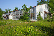 The abandoned dinning hall at Lyndonville Air Force Station on East Mountain in East Haven, Vermont. The US Air Force built the North Concord Radar Station on top of East Mountain in 1955. Its name was changed to Lyndonville Air force Station in 1962 and then closed in 1963. In 1961, the station supposedly reported a UFO sighting just a few hours (+/-) before the reported abduction of Barney and Betty Hill on September 19-20, 1961