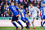 Lucas Vazquez (R) of Real Madrid fights for the ball with Ruben Duarte (C) and Rodrigo Ely of Deportivo Alaves during the La Liga 2017-18 match between Real Madrid and Deportivo Alaves at Santiago Bernabeu Stadium on February 24 2018 in Madrid, Spain. Photo by Diego Souto / Power Sport Images